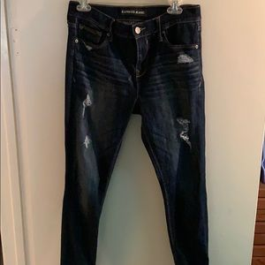 Mid rise skinny blue jeans with light blue patches